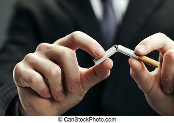 Quit smoking - Human hands breaking cigarette