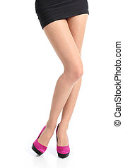Front view of a woman legs with fuchsia high heels posing...
