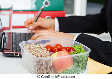 Lunchbox at work - Box with healthy food placed on the...