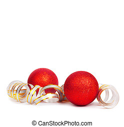 Red Christmas balls with golden streamer isolated on a white...