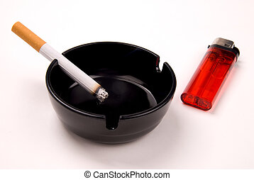 cigarette in ashtray with lighter - cigarette in a black...