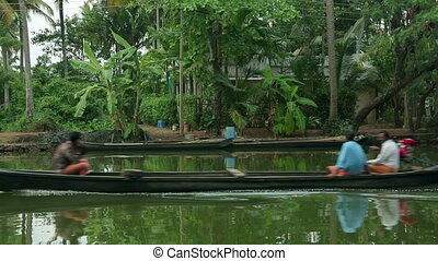 Local people travelling in boat in Kerala Backwaters