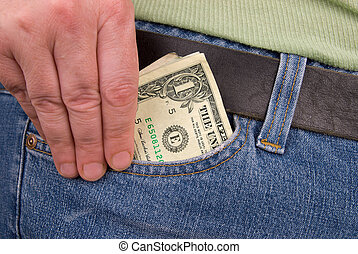 Pocket with Money - pair of jeans with a woman\'s hand...
