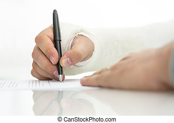 Signing work injury claim - Closeup of injured male hand in...