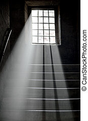 Light shining through window in ancient staircase