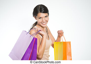 Happy woman shopper with colorful bags full of her recent...