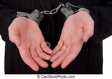 Corporate justice - Business person in suit in handcuffs...