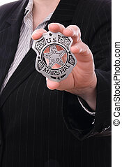 Police detectives badge - Police detective showing her badge