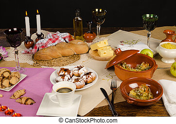 Festive Hanukkah table with an assortment of traditional...