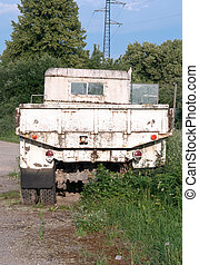 a military truck is neglected in field