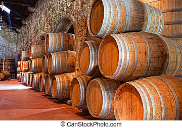 olden casks of different sizes hold Port fortified wine to...