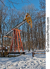 oil pump in winter - oil pump works on winter forest...