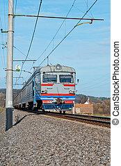 passenger train hauled by electric locomotive