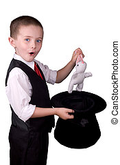 Child Magician - child dressed as a magician pulling a...