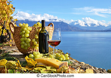 Red wine and grapes on the terrace of vineyard in Lavaux...
