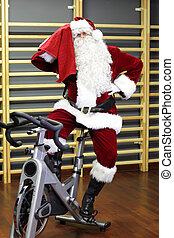 Santa Claus on exercise bike - Santa Claus training on...