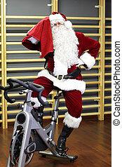 Santa Claus  on exercise bike