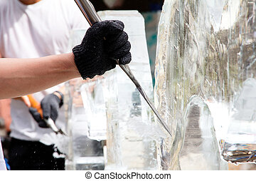 Ice Sculpting - Ice Carver Using Chisel to Carve