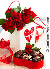 roses and chocolate candies for Valentines Day - red roses...