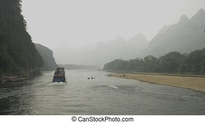 on the Lijiang River to the town of Yangshuo