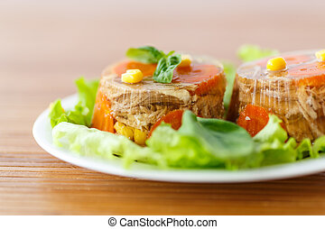meat aspic - jellied meat with carrots garnished with...