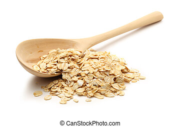 Heap of rolled oats with wooden spoon