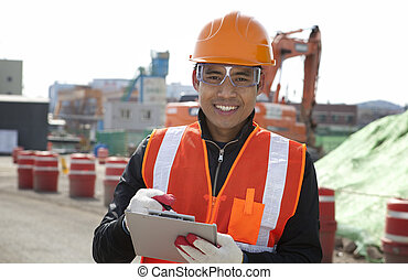 Construction worker - Smiling construction worker standing...