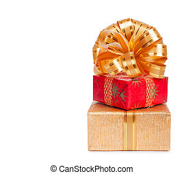 Beautiful Gift box in gold wrapping paper isolated on a...