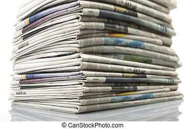Pile of Various newspapers over white background