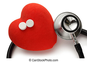 Red heart, stethoscope and pills on white background