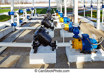 pipes, pump and filter at oil storage - pipes, pump and...