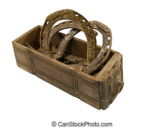 old wooden box with horseshoes