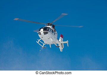 Rescue Helicopter - Mountain rescue helicopter against clear...