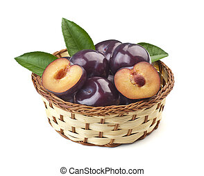 plums in a basket on white background