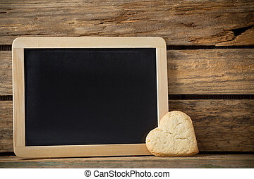 Blackboard - Blackboard on wooden background with heart from...