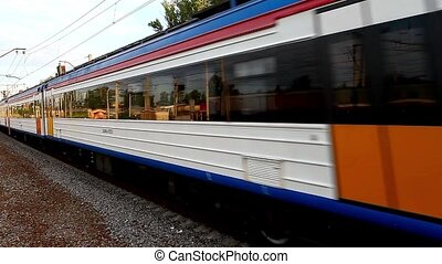 Electric Train - HD1080: Motion train side view. Tripod....