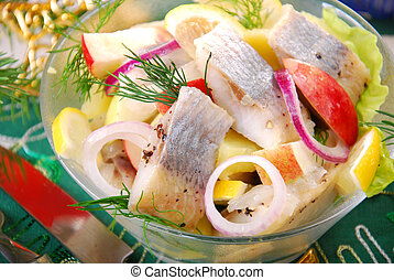 herring salad with apple and potato ,lemon and onion for...