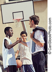 Friendship - Multi-Ethnic Basketball players shaking hands...
