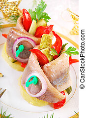 herring appetizer for christmas - appetizer with rolled...