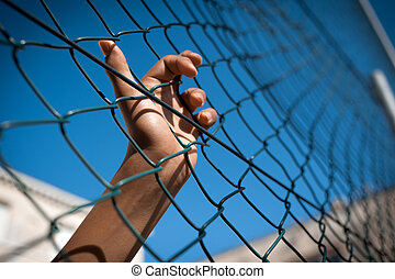 Hand - A boy's hand clinging on to a fence