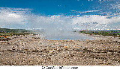 Geyser - Side view of top of Geyser with smoke