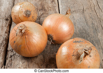 Onions on an old wooden background