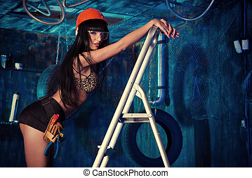 stepladder - Stunningly sexual girl posing with tools in the...
