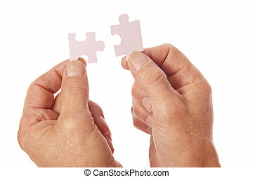 Hands connect jigsaw puzzle pieces - Two hands in silhouette...