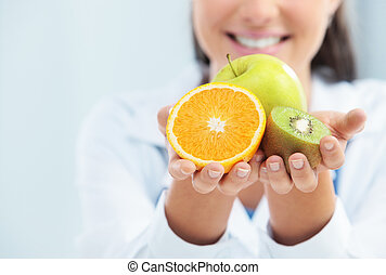 Diet and healthy food - Doctor Nutritionist with Fruit in...
