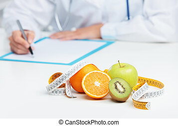 Nutritionist Doctor is writing a prescription. Focus on...