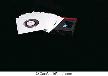 Laser and tape media - CDs, DVDs, in an envelope, and a set...
