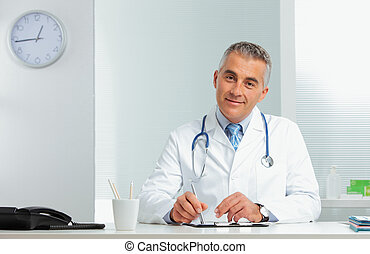 Portrait of a handsome doctor - Mature male doctor sitting...