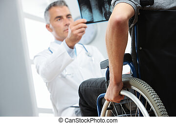 Disabled young man at doctor office - Young patient with...
