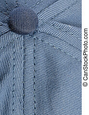 ball cap details - stitching and button detail on blue...